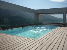 Ver piscinas con deck Timbertech →