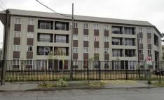 Edificio habitacional con revestimiento Siding DVP Nogal