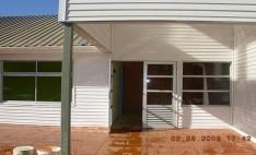 Siding DVP color blanco en fachadas Junji
